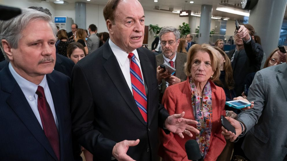 In this Feb. 6, 2019, photo, Sen. Richard Shelby, R-Ala., the top Republican on the bipartisan group bargainers working to craft a border security compromise in hope of avoiding another government shutdown, is joined by Sen. John Hoeven, R-N.D., left, and Sen. Shelley Moore Capito, R-W.Va., right, as they speak with reporters in Washington. Congressional bargainers seem close to clinching a border security agreement that would avert a fresh government shutdown, with leaders of both parties voicing optimism and the top GOP negotiator saying he believes President Donald Trump would back the emerging accord. (AP Photo/J. Scott Applewhite)