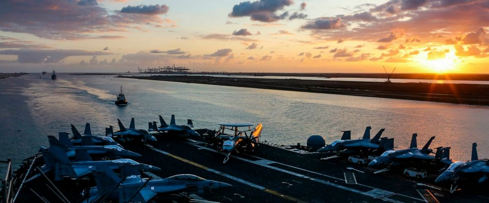 In this Thursday, May 9, 2019 photo released by the U.S. Navy, the Nimitz-class aircraft carrier USS Abraham Lincoln transits the Suez Canal in Egypt. The aircraft carrier and its strike group are deploying to the Persian Gulf on orders from the Whit