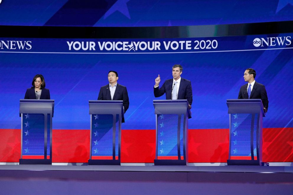PHOTO: Democratic presidential candidates Kamala Harris, Andrew Yang, Beto ORourke and Julian Castro take part in the a debate at Texas Southern University, Sept. 12, 2019, in Houston, Texas.