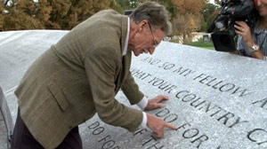 PHOTO Original stone mason John Everett Benson points out lettering he carved in 1965 on memorial wall at President John F. Kennedys tomb at Arlington National Cemetery.