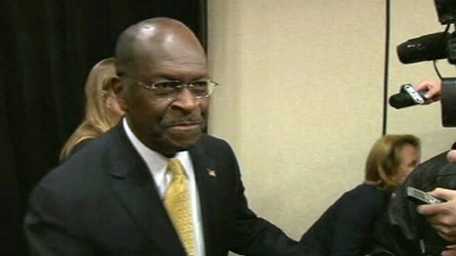 VIDEO: Herman Cain talks to reports about reassessing his campaign.
