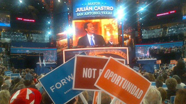 PHOTO: Double-sided signs in Spanish and English were waved at the Democratic National Convention during Julian Castro's speech on September 4, 2012.