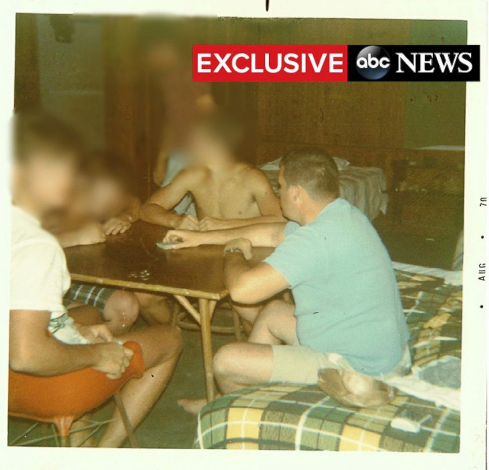 PHOTO: Dennis Hastert, right, plays cards with members of the Explorers Club in the Bahamas.