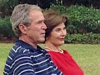 PHOTO: George W. Bush and wife Laura speak with jon Karl
