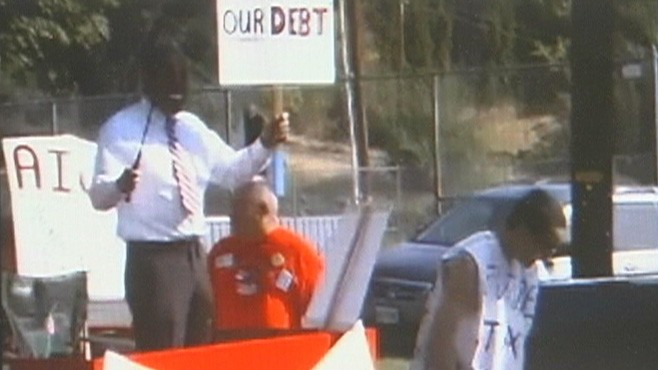 VIDEO: A Tea party float featured a man dressed as President Obama whipping a boy.