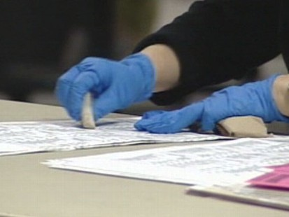 VIDEO: County workers in California are using rubber erasers to scrub smudges on mail-in ballots.