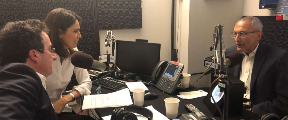 """John Podesta (right) is seen here during an interview with ABC News Cecilia Vega and Chris Vlasto for """"The Investigation"""" podcast."""
