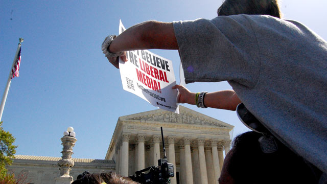PHOTO: Tea Party activists protest outside the Supreme Court, March 26, 2012 in Washington, D.C.