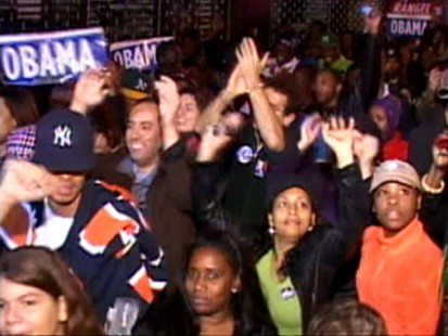 Picture of people celebrating Obamas victory in Harlem.
