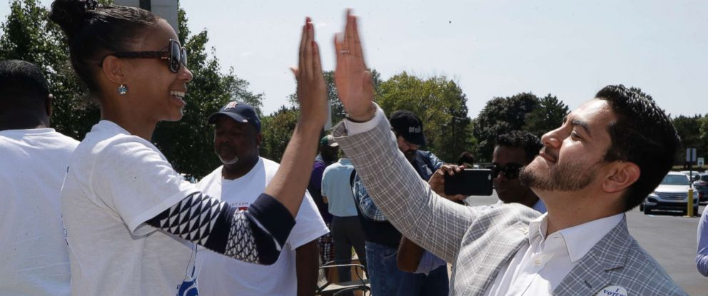 PHOTO: Dr. Abdul El-Sayed high-fives supporter Sonique Watson in Detroit, Aug. 8, 2017.