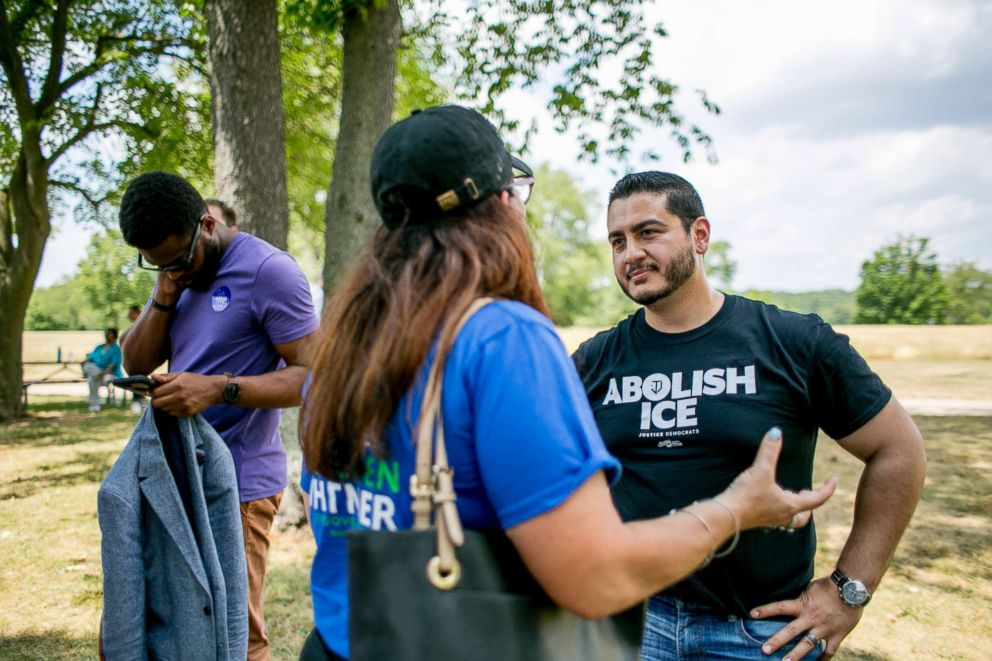 Abdul El-Sayed, a liberal candidate for governor of Michigan, works the crowd at a barbecue in Milford, Mich., July 15, 2018.