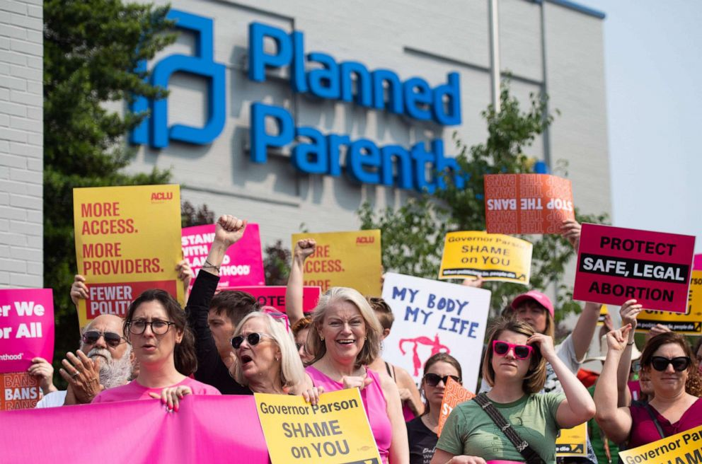 PHOTO: Pro-choice supporters and staff of Planned Parenthood hold a rally outside the Planned Parenthood Reproductive Health Services Center in St. Louis, May 31, 2019.