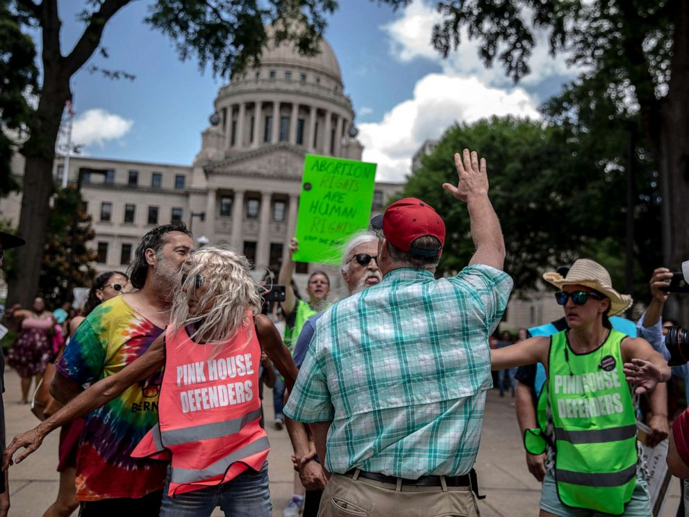 PHOTO: An abortion rights opponent wearing a red hat confronts a rally organized by Planned Parenthood Southeast against the abortion ban bills being legislated across the country, at the Mississippi State Capitol in Jackson, May 21, 2019.