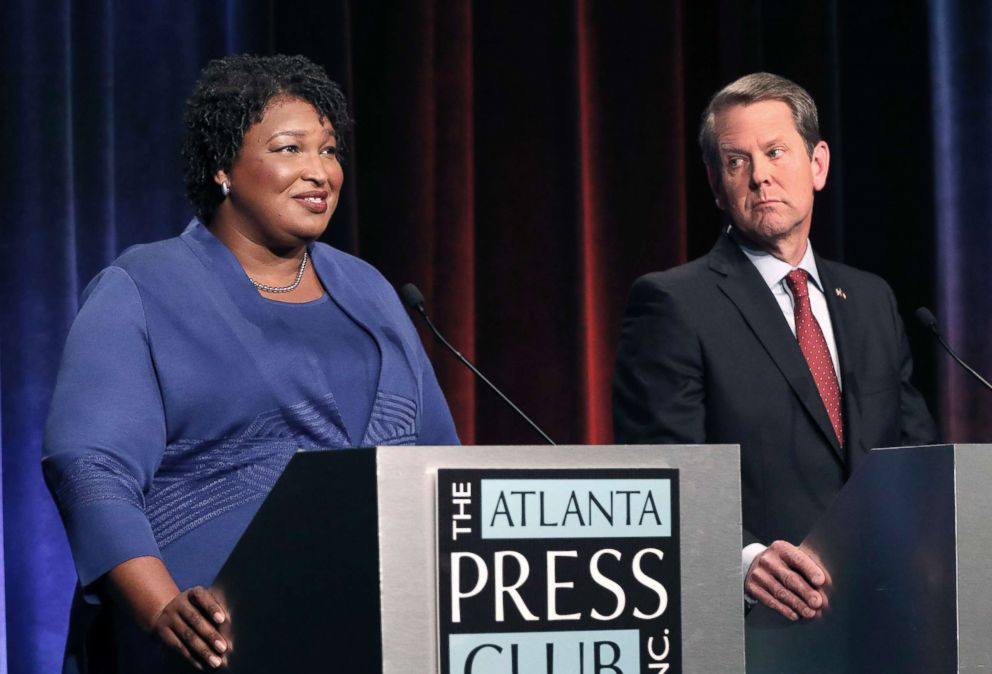 PHOTO: Democratic gubernatorial candidate for Georgia Stacey Abrams, left, speaks as her Republican opponent Secretary of State Brian Kemp listens during a debate in Atlanta, Oct. 23, 2018.