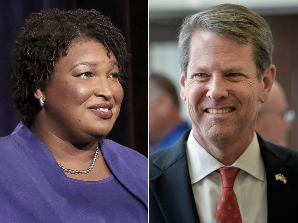 PHOTO: Democratic gubernatorial candidate for Georgia Stacey Abrams speaks during a debate in Atlanta, Oct. 23, 2018. Georgia Secretary of State Brian Kemp talks to voters during a rally in Augusta, Ga., July 23, 2018.