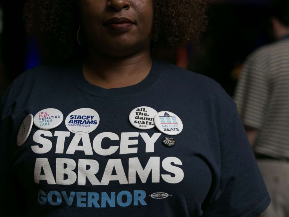 PHOTO: Supporter Nina Durham is adorned with political pins during the primary election night event for Georgia Democratic gubernatorial candidate Stacey Abrams, May 22, 2018, in Atlanta.