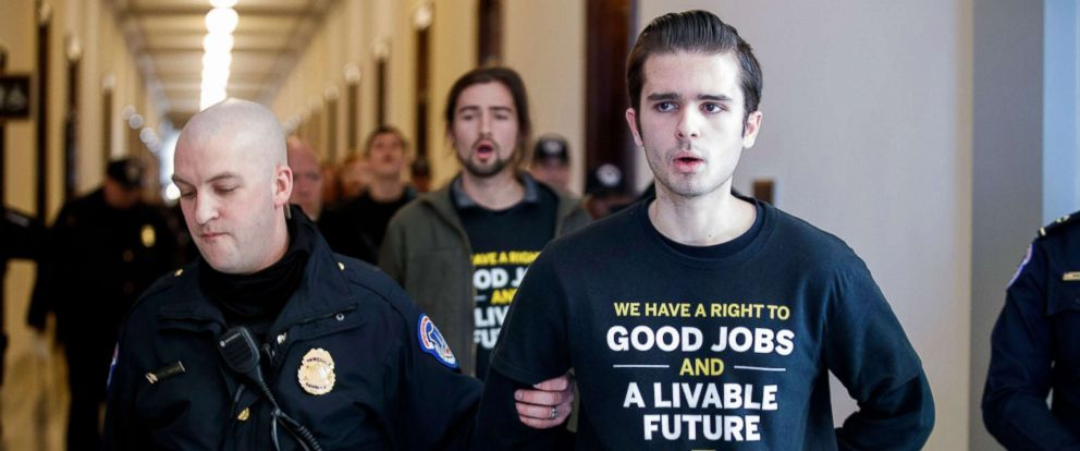 PHOTO: Activists with the Sunrise Movement are arrested after protesting at Senate Majority Leader Mitch McConnells office in the Russell Senate building on Capitol Hill in Washington, DC, Feb. 25, 2019.