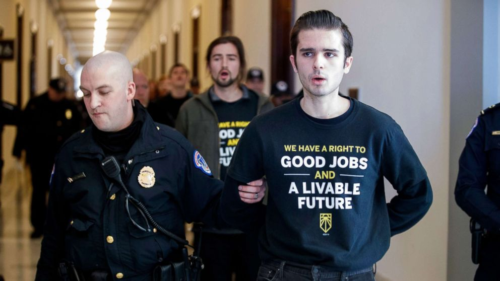 Activists with the Sunrise Movement are arrested after protesting at Senate Majority Leader Mitch McConnell's office in the Russell Senate building on Capitol Hill in Washington, DC, Feb. 25, 2019.