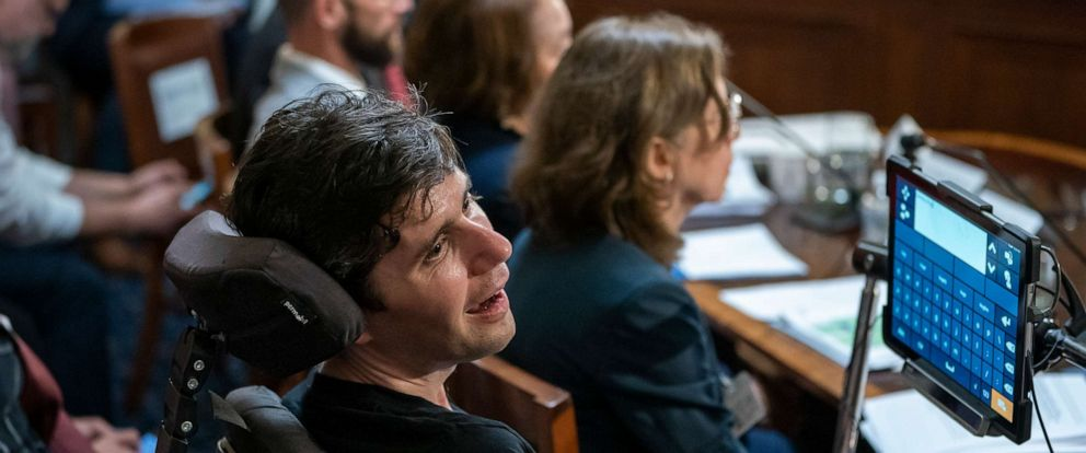 "PHOTO: Ady Barkan, a health care activist who suffers from Amyotrophic lateral sclerosis, testifies before the House Rules Committee at a hearing on a ""Medicare for All"" bill for government-provided health care, on Capitol Hill, April 30, 2019."