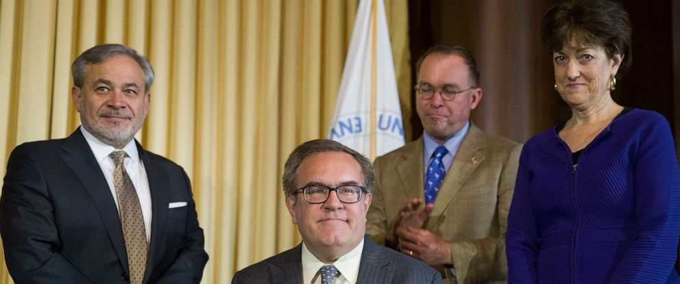 PHOTO: Dan Brouillette, left, Mick Mulvaney, and Mary B. Neumayr, stand as EPA administrator Andrew Wheeler after signing the Affordable Clean Energy Rule during a media availability at the Environmental Protection Agency, June 19, 2019, in Washington.