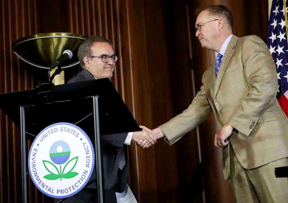 PHOTO: EPA Administrator Scott Wheeler, left, shakes hands with acting White House Chief of Staff Mick Mulvaney after Wheeler signed the Affordable Clean Energy final rule at a ceremony at EPA headquarters, June 19, 2019 in Washington, D.C.