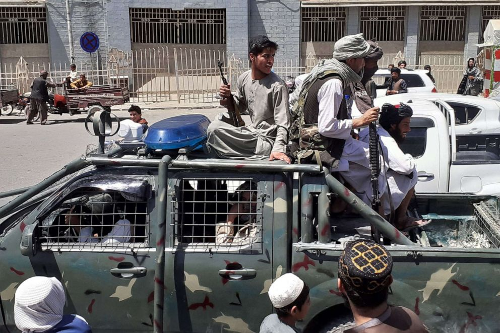 PHOTO: Taliban fighters are pictured in a vehicle of Afghan National Directorate of Security (NDS) on a street in Kandahar on Aug. 13, 2021.