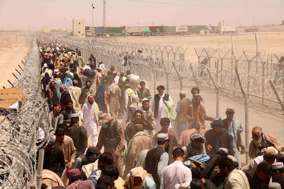 PHOTO: People stranded at the Pakistani-Afghan border wait to cross the border after it was reopened at Chaman, Pakistan, on Aug. 13, 2021.