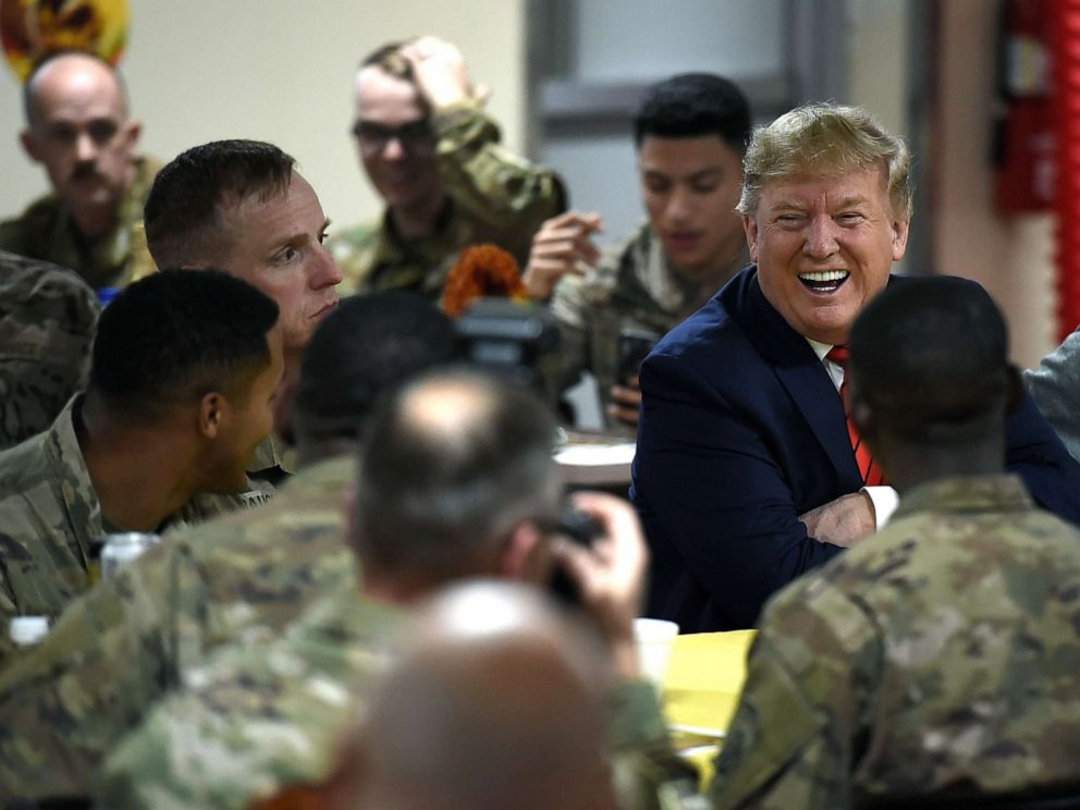 Image result for trump visits troops for thanksgiving