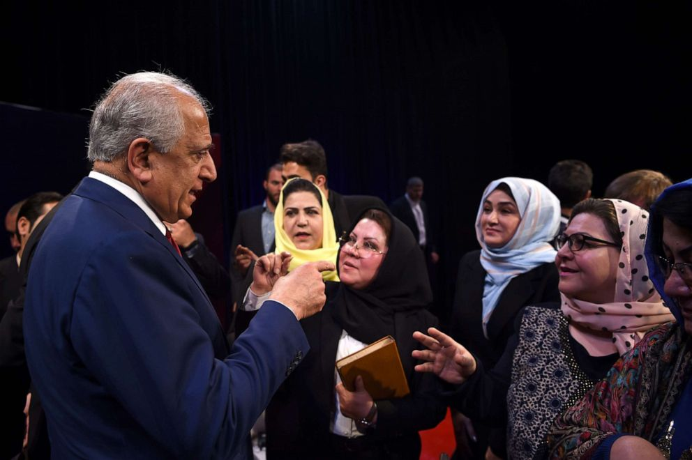 PHOTO:US special representative for Afghan peace and reconciliation Zalmay Khalilzad (L) interacts with the audience after a forum talk with Afghan director of TOLO news Lotfullah Najafizada, April 28, 2019.