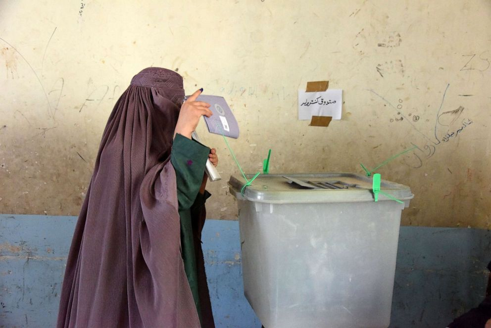 PHOTO: An Afghan woman voter casts her ballot at a polling center for the countrys legislative election in Kandahar province, Oct. 27,2018.