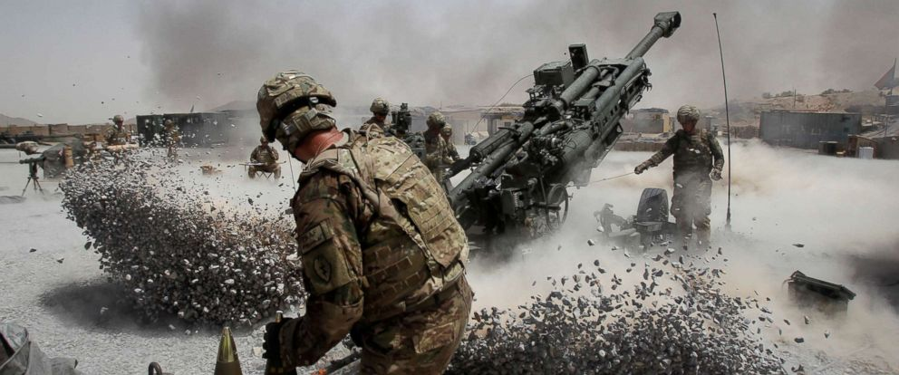 PHOTO: U.S. Army soldiers from the 2nd Platoon, B battery 2-8 field artillery, fire a howitzer artillery piece at Seprwan Ghar forward fire base in Panjwai district, Kandahar province southern Afghanistan, June 12, 2011.