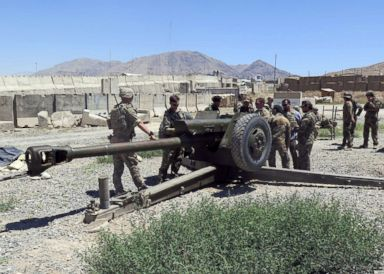 PHOTO: U.S. military advisers work with Afghan soldiers at an artillery position on an Afghan National Army base in Maidan Wardak province, Afghanistan, Aug. 6, 2018.