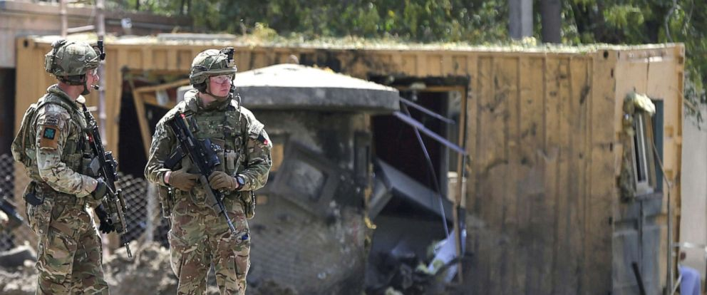 PHOTO: Foreign troops with NATO-led Resolute Support Mission investigate at the site of a suicide attack in Kabul, Afghanistan, Sept. 5, 2019.