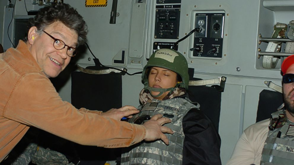 Leeann Tweeden posted this photo online that she says was taken while she was asleep on a flight back from a 2006 USO trip. She says it shows then-comedian Al Franken, who is now a U.S. Senator, groping her.