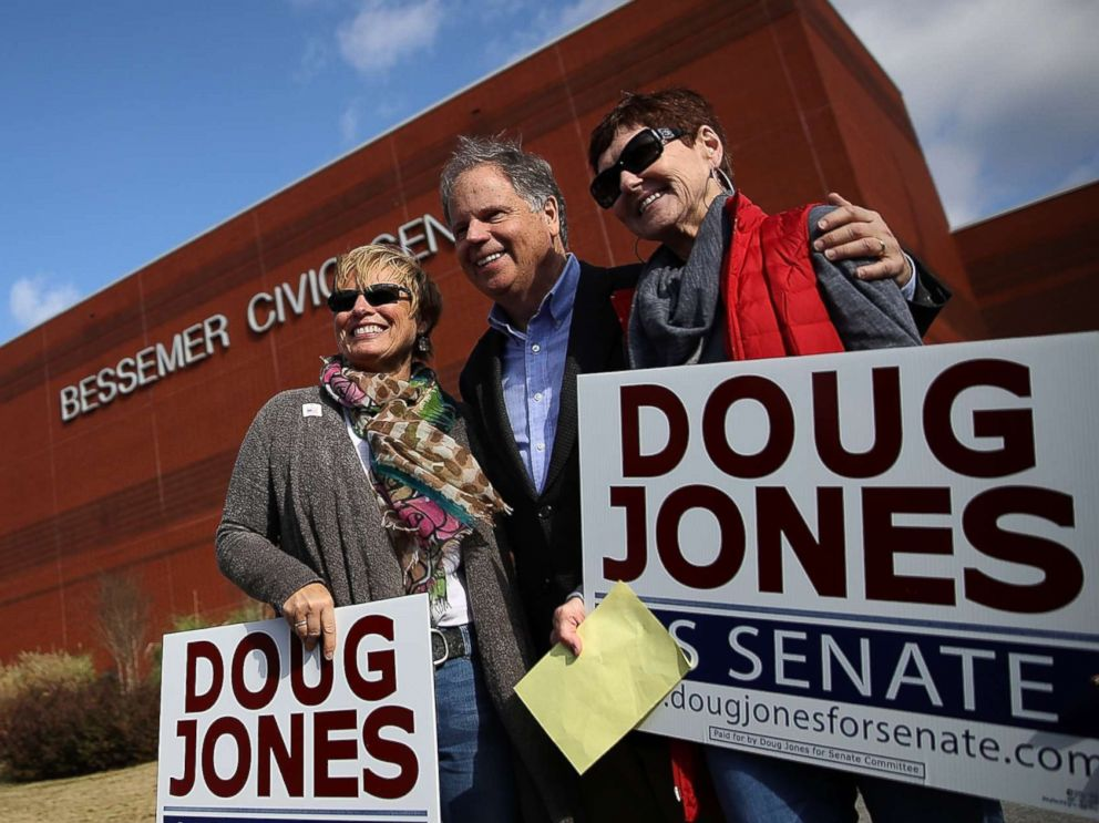 PHOTO: Democratic senatorial candidate Doug Jones takes a picture with voters outside of a polling station at the Bessemer Civic Center on Dec. 12, 2017 in Bessemer, Ala.