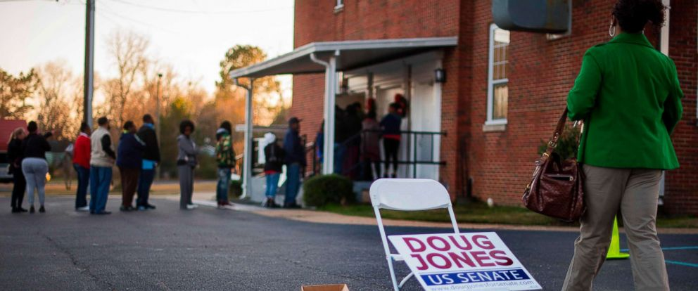 PHOTO: A woman walks over to get in line to vote at Beulah Baptist Church polling station in Montgomery, Ala. on Dec. 12, 2017.