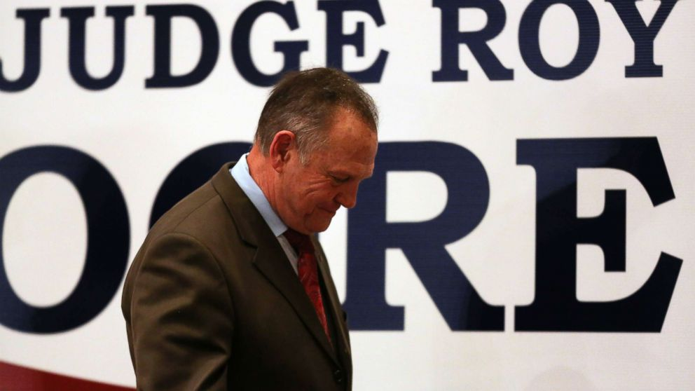Republican Senate candidate Roy Moore walks off stage saying he would not concede defeat till all the votes were in and possibly demand a recount, at his watch party in Montgomery, Ala., Dec. 12, 2017.