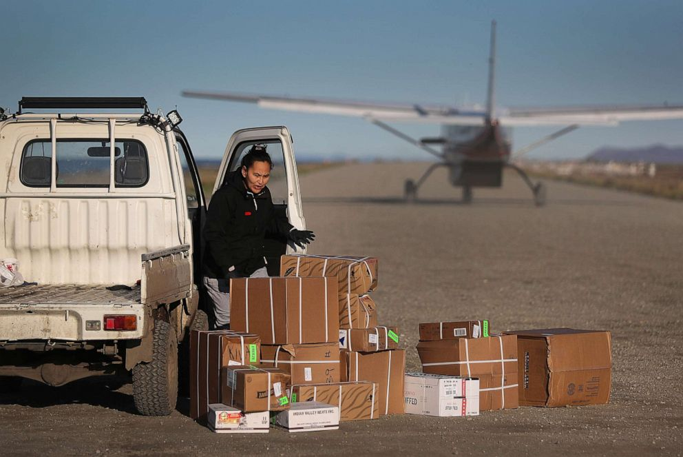 PHOTO: Supplies are dropped off by a plane on the dirt runway, Sept. 14, 2019 in the remote village of Kivalina, Alaska. Supplies needed for the town are brought in either by barge or plane since there are no roads leading connecting it to other towns.