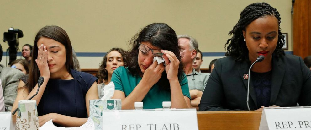 PHOTO: Rep. Rashida Tlaib, center, alongside Alexandria Ocasio-Cortez, left, wipes her eyes after testifying before the House Oversight Committee hearing on family separation and detention centers, July 12, 2019, on Capitol Hill in Washington.