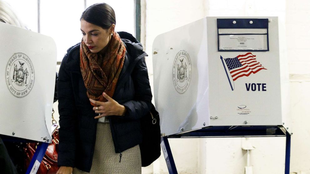 Alexandria Ocasio-Cortez casts her vote in the 2018 mid-term general election at a polling site in the Bronx, New York, Nov. 6, 2018.
