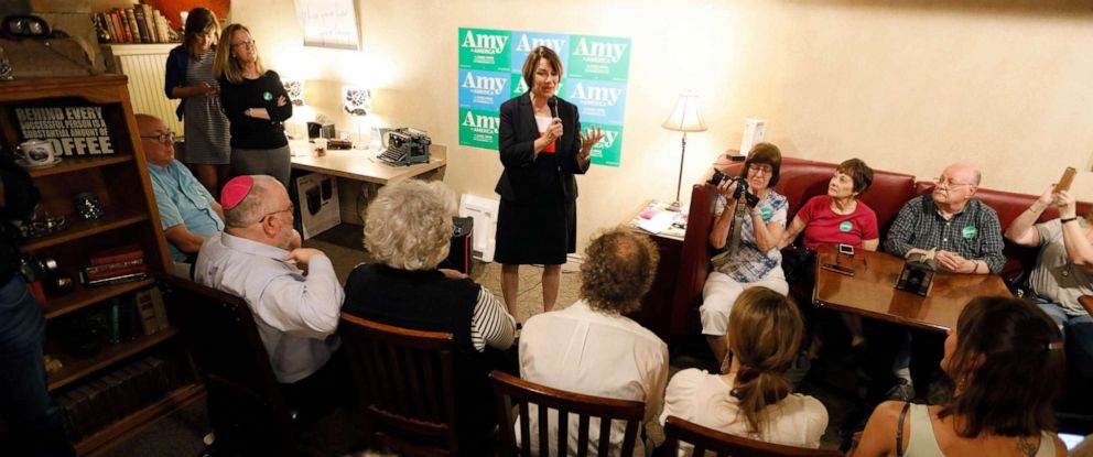 PHOTO: Democratic presidential candidate Sen. Amy Klobuchar, D-Minn., speaks to local residents during a meet and greet at a coffee shop, May 25, 2019, in Iowa Falls, Iowa.