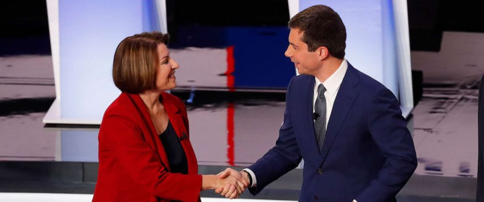 PHOTO: Sen. Amy Klobuchar and South Bend Mayor Pete Buttigieg shake hands before the first of two Democratic presidential primary debates hosted by CNN, July 30, 2019, in Detroit.