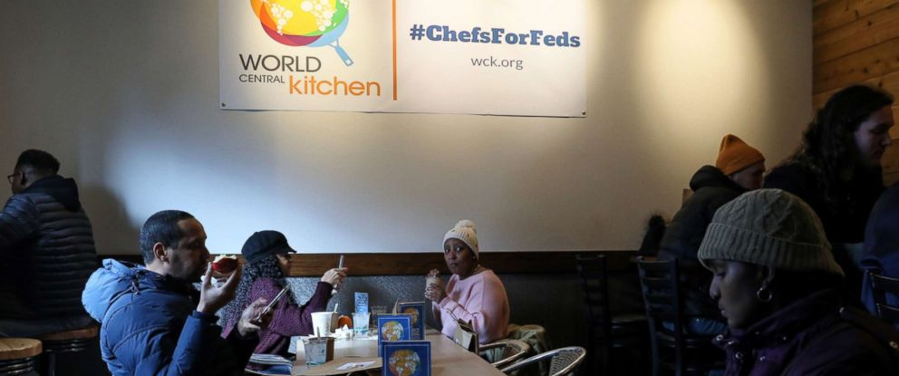 PHOTO: Federal workers left unpaid or furloughed by the extended partial government shutdown eat free food and drink coffee at the World Central Kitchen, a volunteer emergency kitchen run by Chef Jose Andres, in Washington, Jan. 16, 2019.