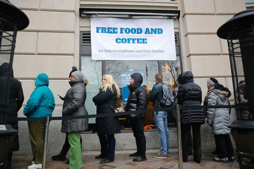 PHOTO: People wait in line at Chef Jose Andres World Central Kitchen for free meals to workers effected by the government shutdown in Washington, Jan. 16, 2019.