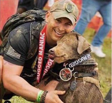 PHOTO: Officer Andrew Einstein is pictured with his service dog.