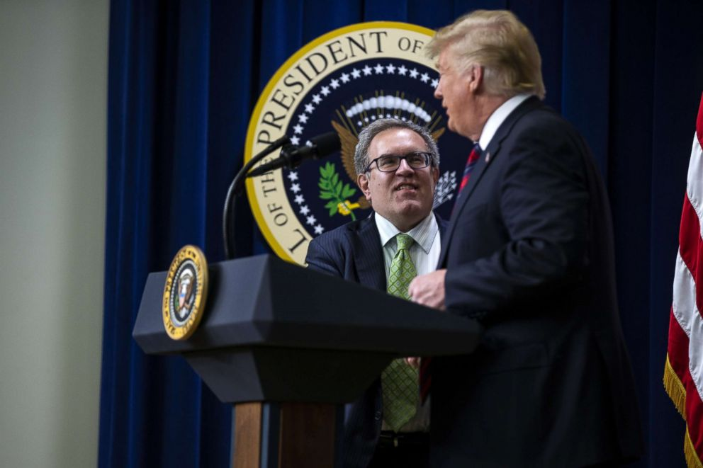 PHOTO: Andrew Wheeler, acting administrator of the Environmental Protection Agency, arrives on stage with President Donald Trump during the White House State Leadership Day conference in Washington, Oct. 23, 2018.