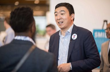 PHOTO: Democratic presidential candidate Andrew Yang talks with potential voters after a Black Caucus meeting on May 18, 2019, in Columbia, S.C.