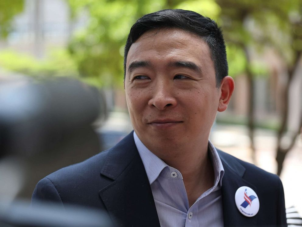 PHOTO: Democratic presidential candidate Andrew Yang speaks to media outside the Knight Concert Hall of the Adrienne Arsht Center for the Performing Arts of Miami-Dade County June 26, 2019, in Miami.