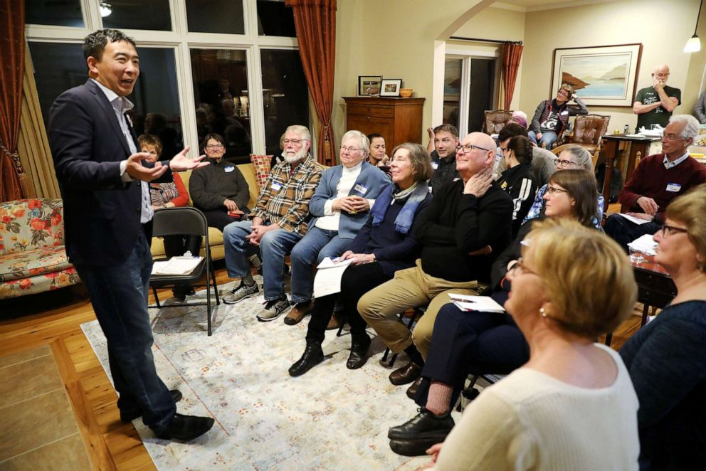 PHOTO: U.S. 2020 Democratic presidential candidate Andrew Yang speaks at Potluck Insurgency, a local democratic activist event, at the home of one of its members in Iowa City, Iowa, March 10, 2019.