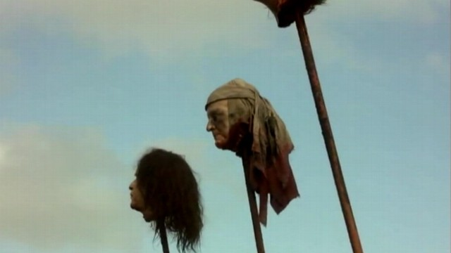 VIDEO: Severed replica of Bushs head mounted on a stake appears in some scenes.